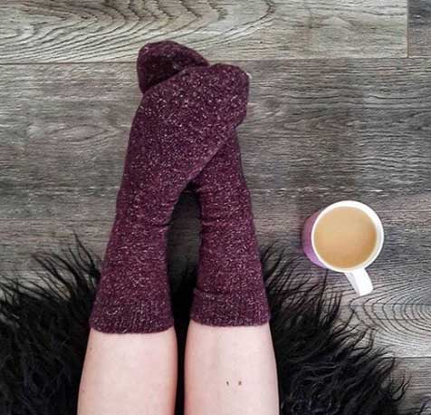 cosy wool socks with a cup of tea